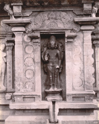 Close view of niche with full-length sculpture of Brahma on south wall of the shrine of the Nageshvara Temple, Kumbakonam